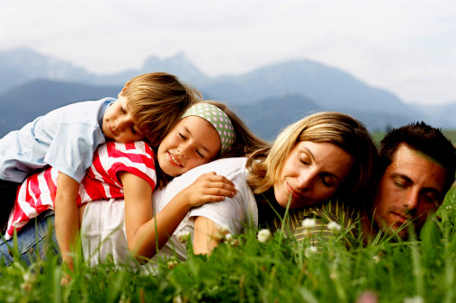 Young family resting in countryside